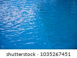 blue water surface background.... | Shutterstock . vector #1035267451
