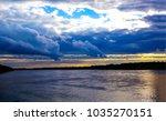 sunset river cloudy sky... | Shutterstock . vector #1035270151