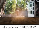 empty dark wooden table in... | Shutterstock . vector #1035270229
