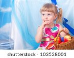 little girl with basket of... | Shutterstock . vector #103528001