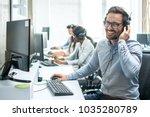 smiling handsome customer... | Shutterstock . vector #1035280789