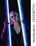 smiling fashionable girl posing ... | Shutterstock . vector #1035287761