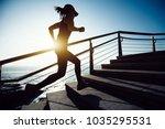sporty female runner running... | Shutterstock . vector #1035295531