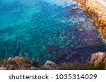 spain in winter  rock and sea... | Shutterstock . vector #1035314029