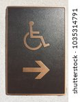 Small photo of Brass colored handicap access sign