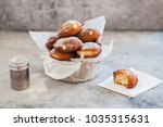 doughnuts with creamy lemon... | Shutterstock . vector #1035315631