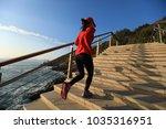 sporty female runner running... | Shutterstock . vector #1035316951