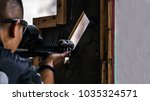 male with rifle in hands aimimg ... | Shutterstock . vector #1035324571