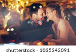 romantic couple dating in pub... | Shutterstock . vector #1035342091
