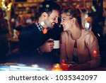 romantic couple dating in pub... | Shutterstock . vector #1035342097
