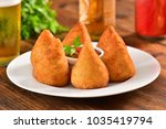 deep fried snack   coxinha | Shutterstock . vector #1035419794