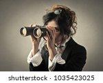 looking through binoculars | Shutterstock . vector #1035423025