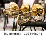 Trombones Lying On The Chairs...