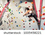 woman practicing rock climbing... | Shutterstock . vector #1035458221