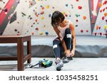 woman ready for practice rock...   Shutterstock . vector #1035458251