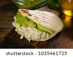 Small photo of Reina pepeada, Arepa, corn bread with chicken and avocado