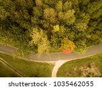 aerial view of a forest on road ... | Shutterstock . vector #1035462055