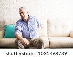 mature man with gray hair... | Shutterstock . vector #1035468739