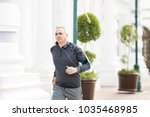 fit middle aged hispanic man... | Shutterstock . vector #1035468985