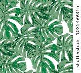 tropical leaves. seamless... | Shutterstock .eps vector #1035469315