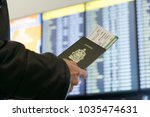 a man with a canadian passport... | Shutterstock . vector #1035474631