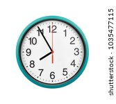 Small photo of Blue wall clock isolated on white background. Arrows of a clock on a white background, for the possibility of using any time.