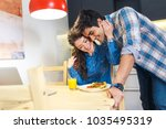 young couple sitting by table... | Shutterstock . vector #1035495319
