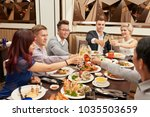 multiethnic friends clinking... | Shutterstock . vector #1035503659