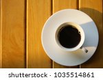 coffee in a white cup on wooden ... | Shutterstock . vector #1035514861