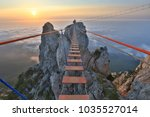 suspension bridge in mountain | Shutterstock . vector #1035527014