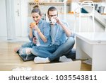 young couple watching movie on... | Shutterstock . vector #1035543811