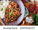 kung pao chicken with peppers... | Shutterstock . vector #1035545227