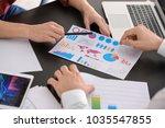 young men working in office.... | Shutterstock . vector #1035547855