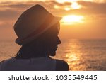 silhouette of a young girl with ... | Shutterstock . vector #1035549445