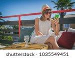 cute girl using cellphone and... | Shutterstock . vector #1035549451