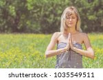 young woman doing yoga on a... | Shutterstock . vector #1035549511