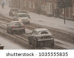 traffic chaos in blizzard... | Shutterstock . vector #1035555835