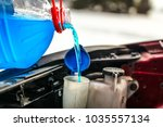 detail on pouring antifreeze... | Shutterstock . vector #1035557134