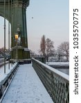 Small photo of Hammersmith Bridge with snow in the morning before the Beast From The East.