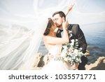 happy and romantic scene of... | Shutterstock . vector #1035571771