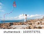 beautiful happy young woman... | Shutterstock . vector #1035573751