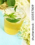 refreshing summer drink made from elder flowers and mint - stock photo