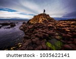 Man standing on top of basalt...