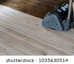 sanding hardwood floor with the ... | Shutterstock . vector #1035630514