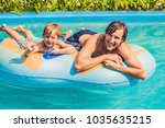 father and son have fun at the... | Shutterstock . vector #1035635215