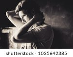 sexy man in grange interior | Shutterstock . vector #1035642385