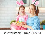 happy easter  family mother and ... | Shutterstock . vector #1035647281
