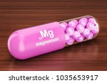 capsule with magnesium mg... | Shutterstock . vector #1035653917