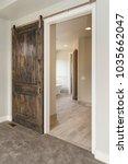 modern rustic sliding barn door | Shutterstock . vector #1035662047