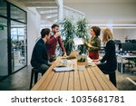 cropped shot of four colleagues ... | Shutterstock . vector #1035681781